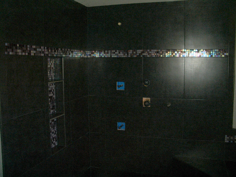 Porcelain and glass master bathroom shower tile installation in Loveland, Colorado