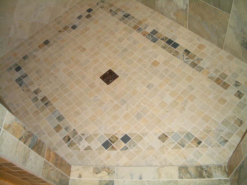 Porcelain master bathroom steam shower floor tile installation in Fort Collins, Colorado