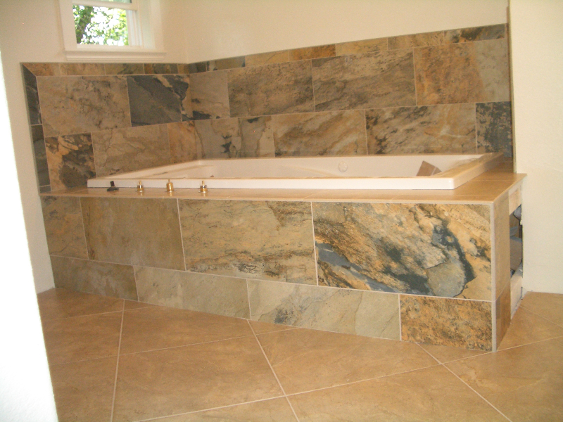 Porcelain master bathroom tub deck tile installation in Fort Collins, Colorado