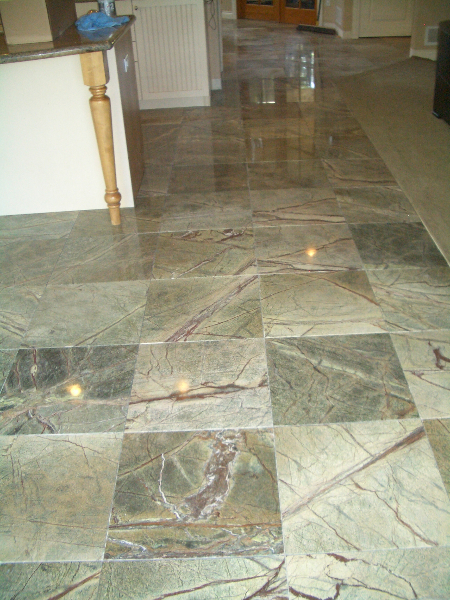 Rainforest green marble floor tile installation in Longmont, Colorado
