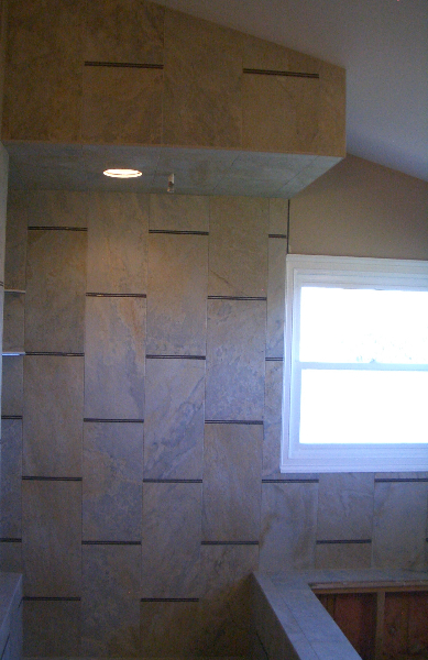 Porcelain and glass master bathroom shower tile installation in Windsor, Colorado