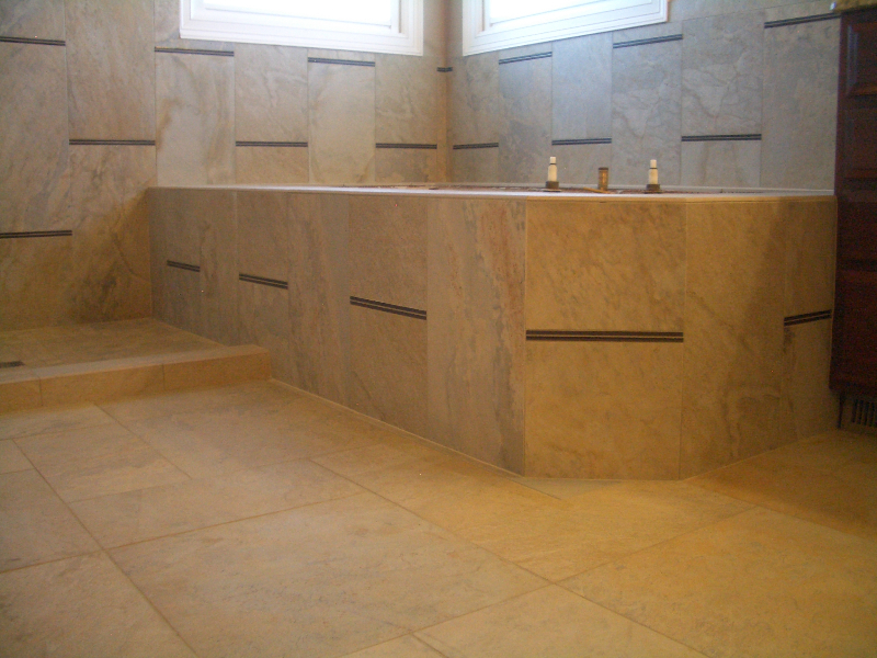 Porcelain and glass master bathroom tub tile installation in Windsor, Colorado