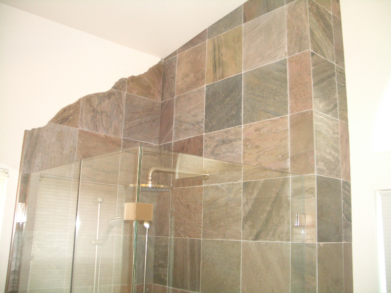 Slate shower tile installation with mountain silhouette in Erie, Colorado
