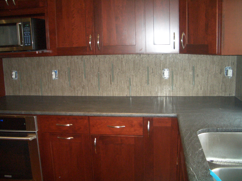 Marble and glass tile kitchen backsplash installation in Northern Colorado