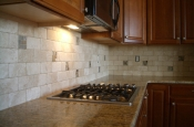 Travertine and glass kitchen backsplash tile installation in Fort Collins, Colorado