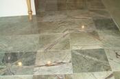 Rainforest green marble floor tile installation in Longmont, Colorado