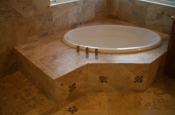 Travertine and glass master bathroom tile installation in Windsor, Colorado