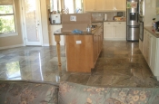 Rainforest green marble tile floor installation in Longmont, Colorado