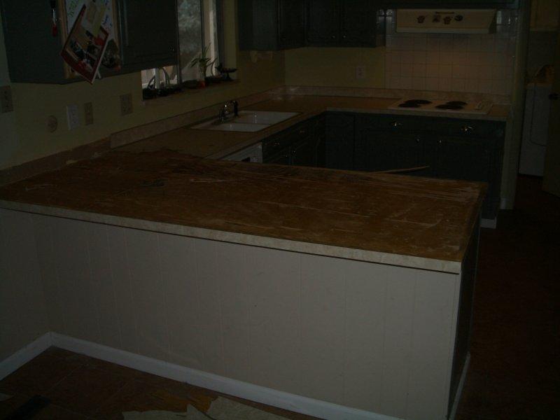 kitchen granite tile countertop and glass backsplash before