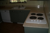Kitchen Granite Tile Countertop and Glass Backsplash before 1