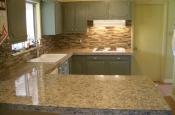 Kitchen Granite Tile Countertop and Glass Backsplash Finished