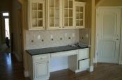 Porcelain kitchen backsplash with granite inserts