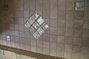 Porcelain mosaic backsplash with glass inserts