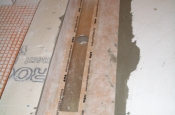 Schluter in-line linear drain in master bathroom shower