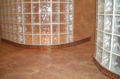 Taconic slate, dual glass block walled master bathroom shower with glass mosaics curb