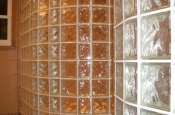 Dual curved glass block walls in master bathroom shower