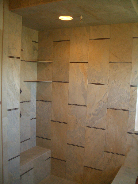 9 x 18 porcelain and glass tile master shower tile installation