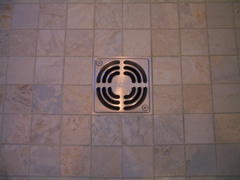 Close-up of Schluter kerdi shower drain in shower floor