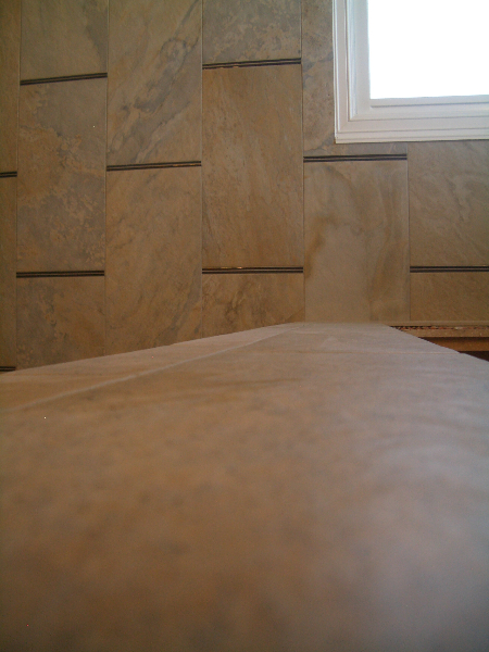 Close-up of porcelain tub deck in master bathroom