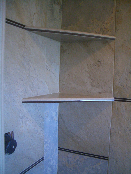 Close up of pencil rail across shower shelf