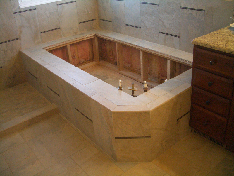 Master bathroom porcelain and glass tub deck