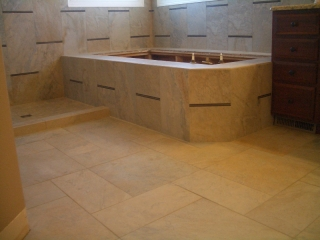 Porcelain and glass master bathroom tub deck