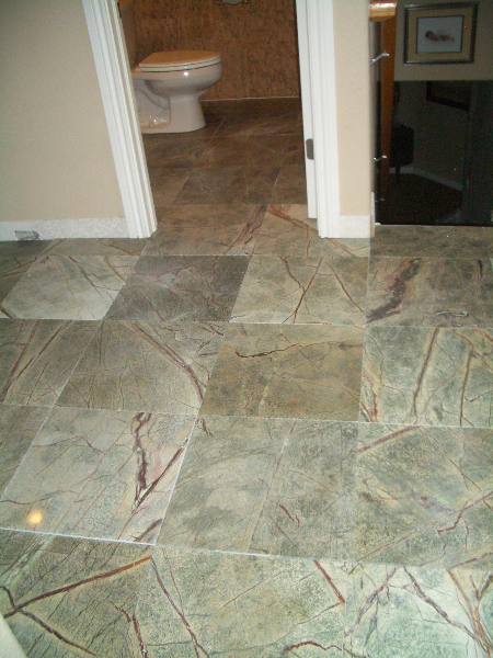 Large format marble tile floor installation