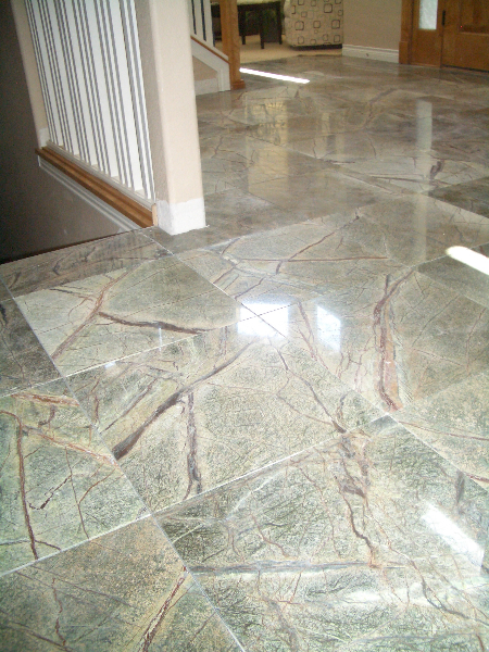 Rainforest green marble tile installation