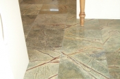 Marble floor tile installation in kitchen