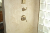 Master bathroom marble and glass block shower in Fort Collins, Colorado