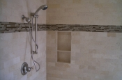 Travertine and glass master bathroom shower in Erie, Colorado