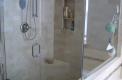 Travertine and glass master bathroom shower installation in Erie, Colorado