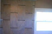 Porcelain and glass master bathroom tile installation in Windsor, Colorado
