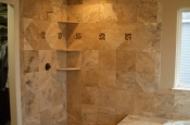 Travertine and glass master bathroom shower tile installation in Windsor, Colorado