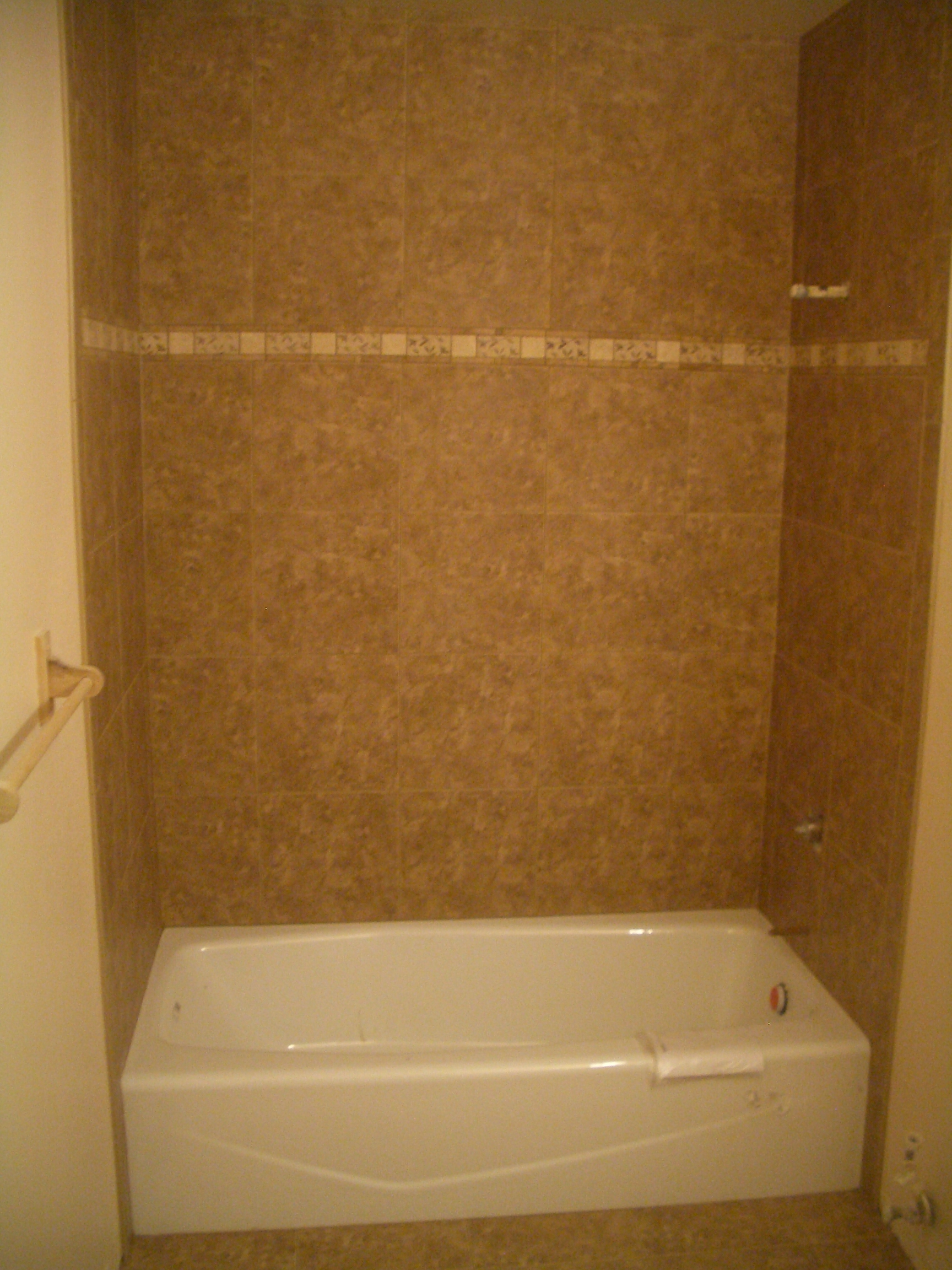 Porcelain tile shower with travertine band Tile bathroom