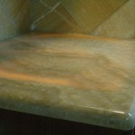 Backlit kitchen onyx slab countertop with honey onyx backsplash Fort Collins
