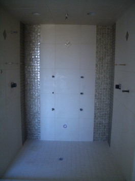 Porcelain Steam Shower with glass tile inserts in Loveland, Colorado
