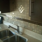 Completed porcelain backsplash with glass inserts