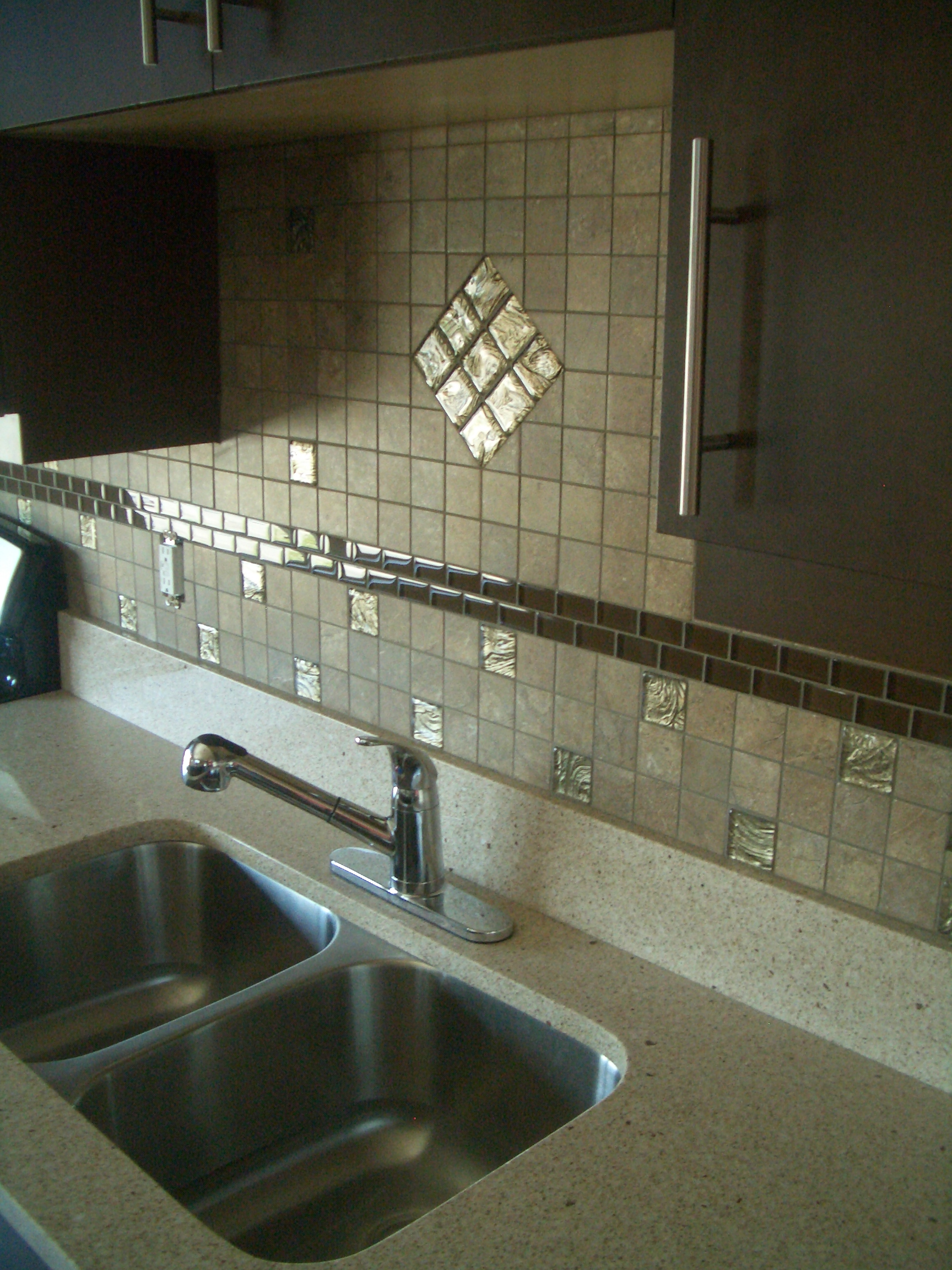 recently finished installing a porcelain tile backsplash with glass