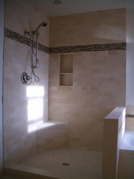 Travertine subway tile shower with glass inserts