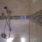 Close-up of glass mosaic tile in travertine subway shower
