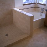 Travertine subway bathroom with glass inserts