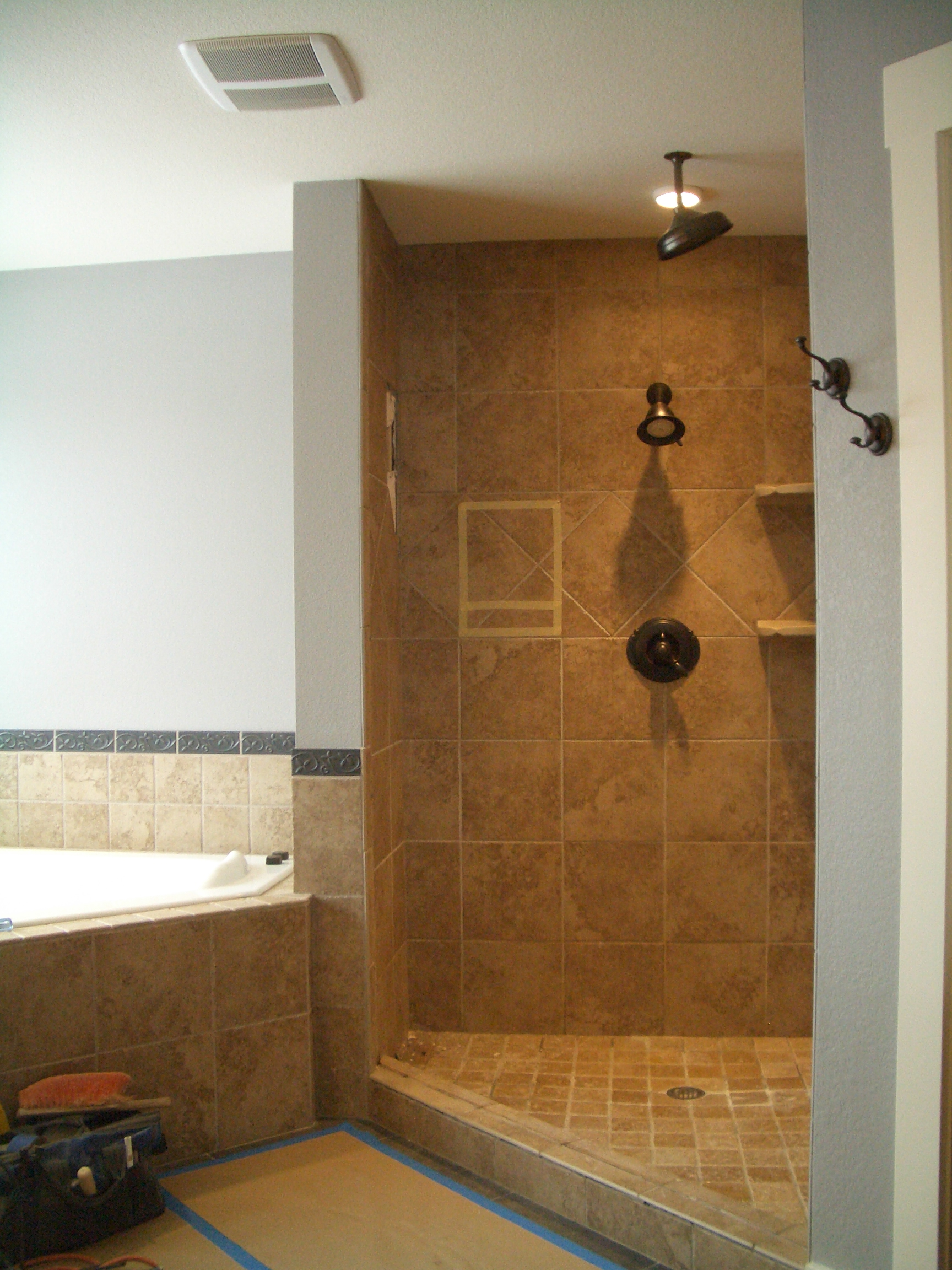 Kerdi master bathroom shower remodel in fort collins for Pictures of bathroom tile designs