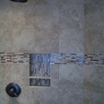 Kerdi shower remodel with glass and travertine liner / listello