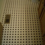 Octagonal mosaic tile floor installation with black dot in Loveland, CO