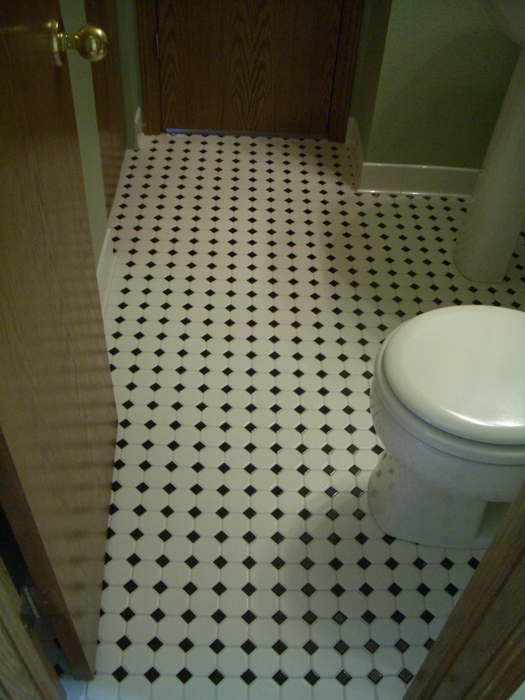 Octagonal mosaic tile floor installation with black dot in Northern