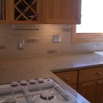 Porcelain Tile Kitchen Backsplash Installation with Glass Accents and Laticrete SpectraLOCK