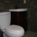 Slate-like porcelain master bathroom with free-standing vanity