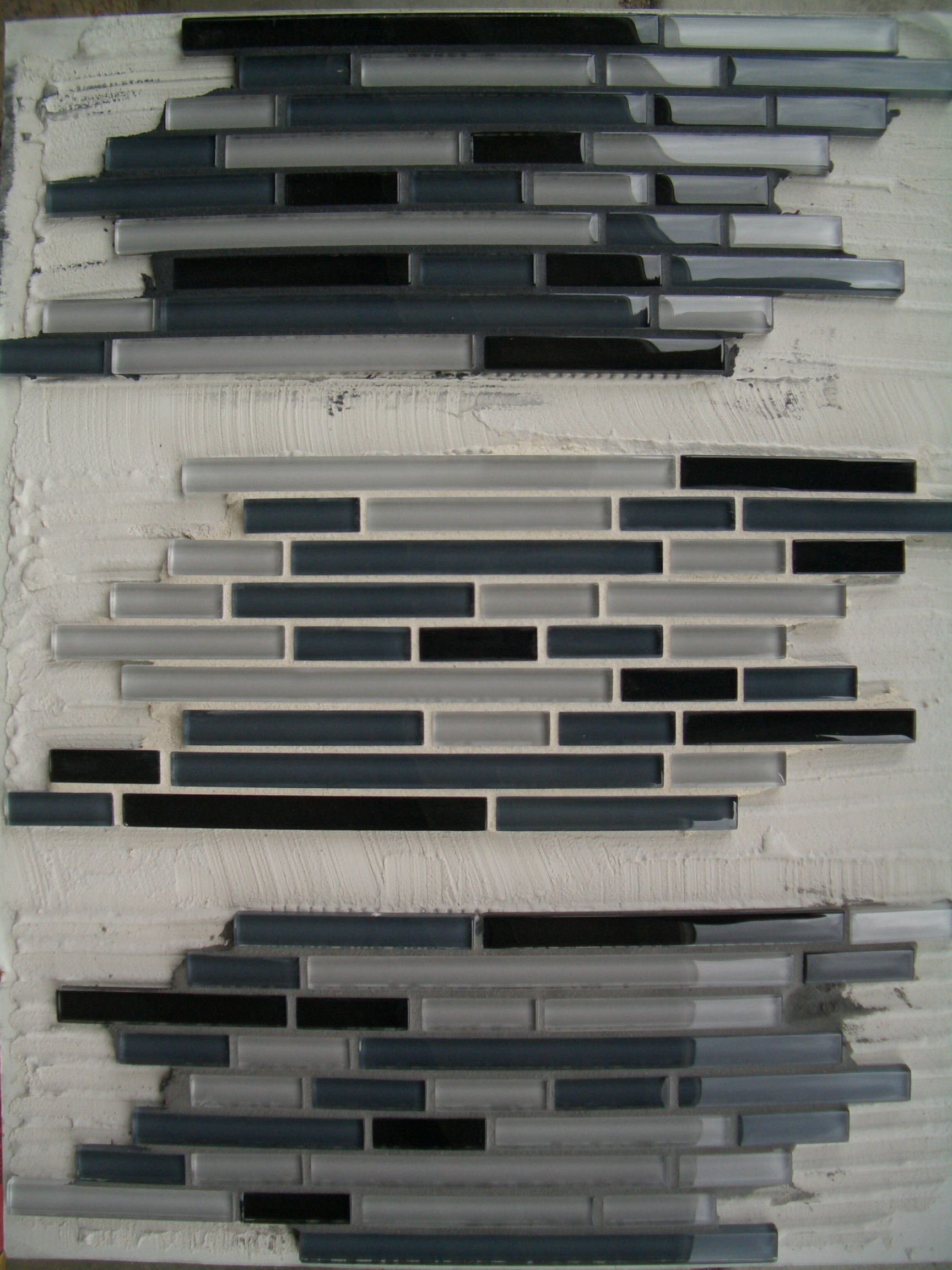 Grout glass tile backsplash