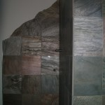 Slate master bathroom shower with mountain silhouette